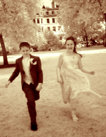 Photojournalism kids in formal attire running in London England park
