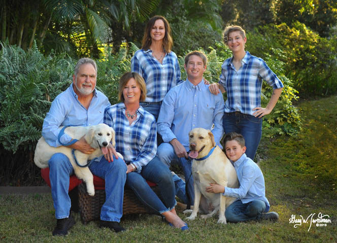 family at home in plaid shirts