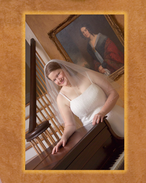 Tessa Pou in home foyer antique painting and piano in home portraiture tampa bay area